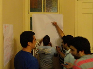 Syrian men and boys affected by GBV participating in a body image and stress management exercises as part of a psycho-social support group session. Photo by Lina Abirafeh.