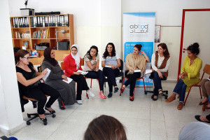 Participants of the Organize Support Groups for Women Victims of GBV training simulating a support group session among Syrian refugee women. Photo by Lina Abirafeh.