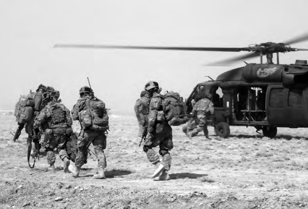 Members of the 10th Mountain Infantry Division board a UH-60 Blackhawk helicopter in Logar Province, Afghanistan. Photo courtesy of Danny Sogn.