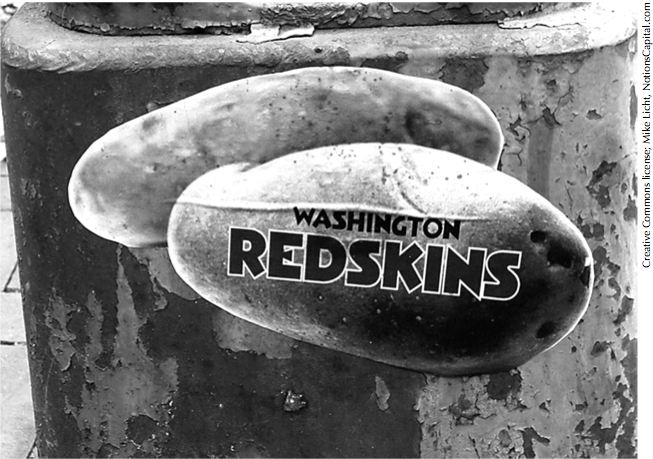 A sticker near Eastern Market in Washington, D.C., parodies the objectifying Redskins logo.