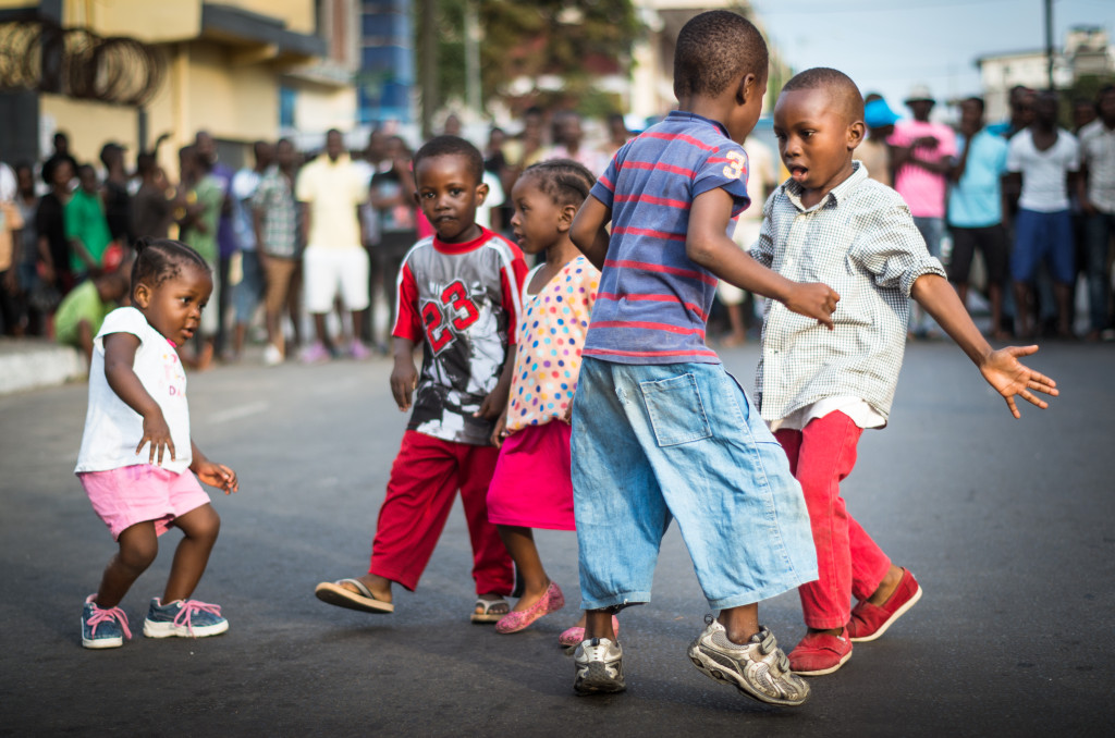 Children dancing to the sounds of rap in Monrovia, Liberia. Photo by Ingrid Gercama.