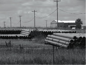 Stockpile of Keystone XL pipes near Buffalo, South Dakota. Photo by David Bond.