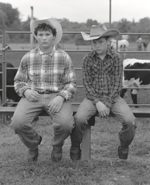 Figure 13. Thomas Donaldson, age 13, and Dalton Clubs, age 14, at a rodeo in Desloge, Missouri. Dalton often competes in peewee bull-riding competitions at local rodeos. Although only an hour from St. Louis, the Old Lead Belt is a semirural community where farming is omnipresent and rodeos are frequent community events. Due to widespread contamination in the area, children such as Dalton are regularly tested by the state to measure and control their blood- lead levels. As a result, the area's youth are acutely aware of the mining legacy that permeates their landscape.