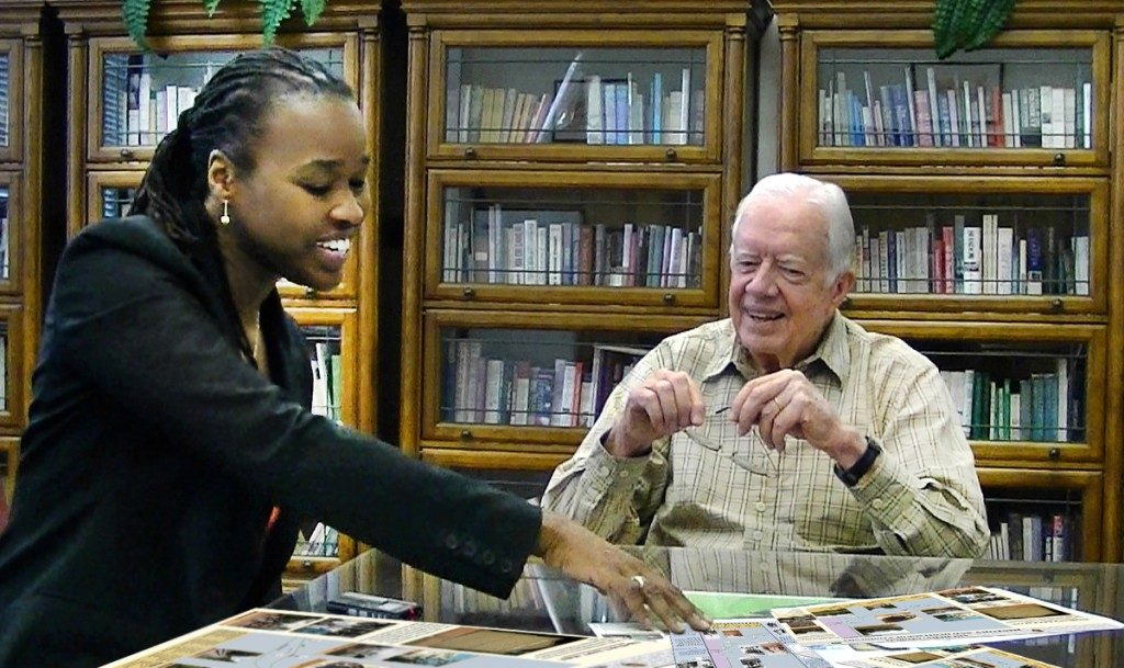 Antoinette Jackson talks with former president Jimmy Carter about the nearly vanished town of Archery, which occupied part of Carter's boyhood farm. Photo courtesy of the USF Heritage Research Lab.